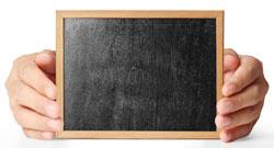 holding blank chalkboard